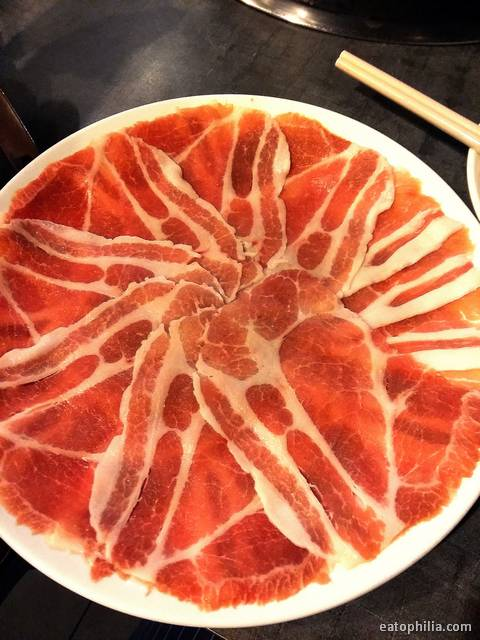Fresh sliced pork we can't resist at Dian Huo Xin Wo