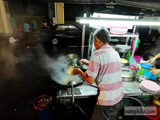 Cooking Char Hor Fun at the Beach Street stall, Penang